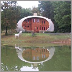 This beautiful Monolithic Dome home in Cloudland, Georgia is a multi-level, prolate ellipsoid. Its Airform measured 60′×37′×27′. (Chuck Peters) — www.monolithic.com