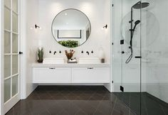 hamptons-style-bathroom-with-round-black-mirror-and-grey-diamond-tile-floor