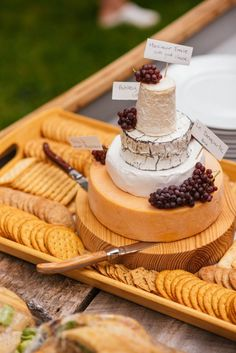 Wedding Reception Food - Cheese wheel wedding cake is one of the most unique alternatives to a traditional wedding cake. This idea is perfect for a vineyard or farm wedding. Cheese Platter Wedding, Cheese Wedding Cakes, Cheese Table Wedding, Tapas, Cheese Tower, Wheel Cake, Cheese Display, Wedding Cake Alternatives, Alternative To Wedding Cake