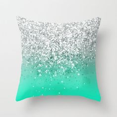 Glittery silver and turquoise pillow.