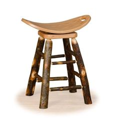 Lots of western charm with this rustic hickory log stool! Choose from Oak or Hickory for the seat and choose Counter or Bar Height.Bring the natural beauty of solid hickory logs to your kitchen or bar area. Saddle Bar Stools, 30 Bar Stools, Swivel Bar Stools, Rustic Log Furniture, Hickory Furniture, Bar Furniture, Rustic Counter Stools, Log Stools, Bar Counter