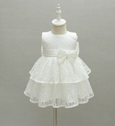 Baby Girl Lace Dress-High Quality! White Big Bow Back Sleeveless Knee Length Baby Girl Tiered Lace Dress  Perfect for wedding, birthday or any special occasion Available from newborn - 24 months Material: Cotton, polyester, lace Please do compare your  little girl measurements with our size chart below before deciding her size