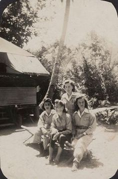 Four flight nurses from the 801st Medical Air Evacuation Squadron pose together in Guadalcanal in 1944 ~