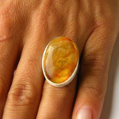 Amber Ring Ovale shape Yellow orange sterling Silver (scheduled via http://www.tailwindapp.com?utm_source=pinterest&utm_medium=twpin&utm_content=post194709597&utm_campaign=scheduler_attribution)