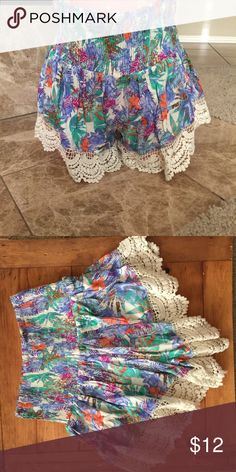 BNWT Bright Tropical Print Shorts Cute bright Tropical Print Shorts with scalloped Crochet hem- BNWT--NOTE: these shorts looks really small but have a ton of stretch/// I usually wear a 5 or 7 in shorts and a medium in these fits me perfect                                                              Material is 100% rayon en creme Shorts
