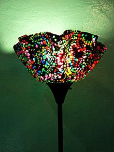 Love these lamps.  The company makes them from recycled Mardi Gras beads.