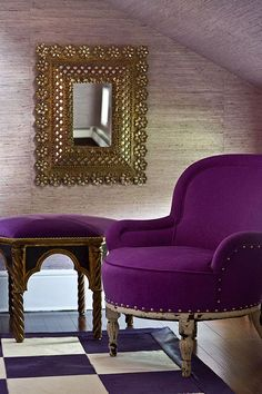 Amethyst upholstery adds an exotic touch to the lavender bedroom.