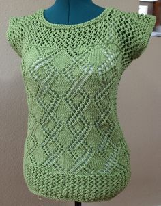 Free Knitting Pattern for Date Night Tunic - Diamond medallis lace pullover sweater pattern with trellis lace yoke and trim by Cathy Payson. Original pattern has long sleeves. Pictured project by MrsFrisby who left off the sleeves. Sizes Small – XX Large