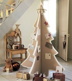 Love the idea of a cardboard tree for pinning Christmas cards to