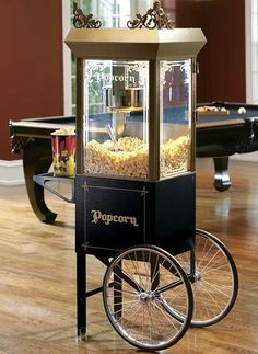 Delight your guests with fresh, flavorful popcorn at every party with the Old-time Popcorn Popper w/Cart that boasts a classic design.