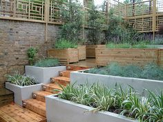 nice split level garden-- Oriental trellis in a modern London garden, and a great solution for a sloped garden