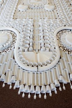 'Carpet' made of disposable cups and utensils by Dutch art collective We Make Carpets.