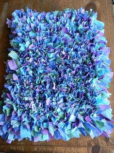 Non slip rug mat + thrift store sheets dyed to your colors Hometalk :: DIY Shag Rug Dorm Decor