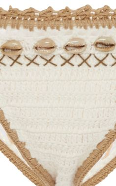 Hailing from Australia's Gold Coast, designer Chloe Dunlop delivers carefree, bohemian swimwear. These **She Made Me** bikini bottoms features a series of cowrie shells woven in with hand embroidered detail.