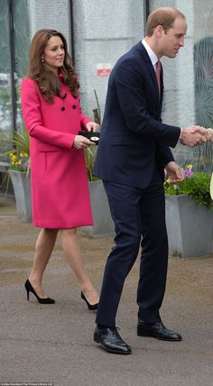 Eight-months-pregnant Kate, dressed in a fuschia coat by designer Mulberry, was on her las...