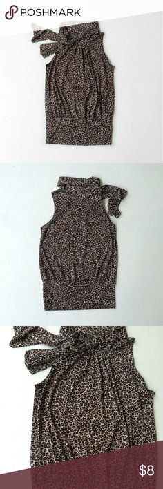 Animal Print Stretch Bubble Tank With Neck Tie In great condition! Size medium 95% polyester 5% spandex Laying Flat: bust 17.5 inches, bottom band 15 inches, 24 inches in length Jason Maxwell Tops Blouses