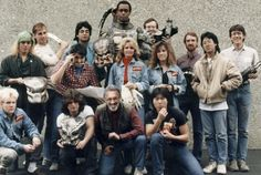 Stan Winston, Kevin Peter Hall, Steve Wang & fellow PREDATOR artists pose for a group shot.