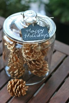 {::Holiday DIY project::} Simple DIY project that will help bring on the holiday spirit, painting a few pine cones with a soft tone of gold and stacking them in a glass jar.