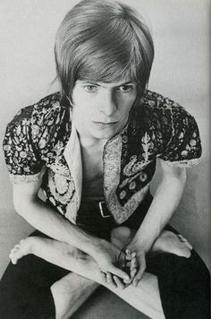 David Bowie practicing yoga in 1967. Loved and pinned by www.downdogboutique.com to our community Pinterest boards.
