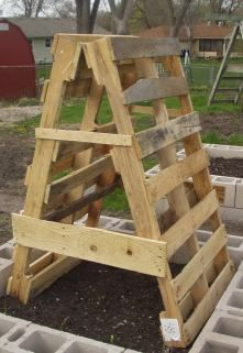 Super simple trellis--very functional and if painted, it could be a colorful addition to a yard.  I like it!