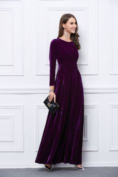 Dress in a purple velvet evening dress to look truly gorgeous. For footwear go down the casual route with metallic leather pumps.   Shop this look on Lookastic: https://lookastic.com/women/looks/evening-dress-pumps-clutch/23138   — Silver Earrings  — Purple Velvet Evening Dress  — Gold Bracelet  — Black Embellished Clutch  — Silver Leather Pumps