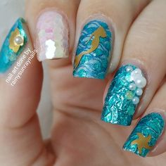 Here are some #mermaidnails using the @essence_cosmetics #aquatix collection I had so much fun with these. I even uploaded a video and blog post on how I created these. Also the nail vinyls are from @lou_it_yourself. Hope you like them. by cuticulanailtape