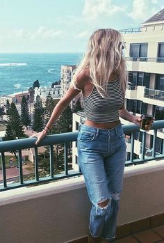 travel | hotels | long blonde hair | summer | striped tank tops | light distressed jeans | casual | tan | balcony