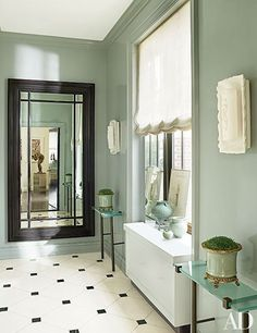 At a Manhattan home by Vicente Wolf, the designer painted the windowed elevator opening in a soft blue-green hue.