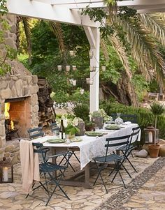 outdoor dining area with fireplace