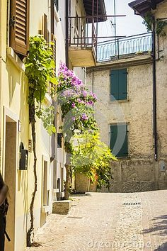 Beautiful old italian street in the summer.Shot taken in the town of Limone, on the shore of lake Garda, near Verona.This looks like it`s a painting. Summer Shots, Italian Street, Lake Garda, Verona, Free Stock Photos, Facade, Architecture, Photography, Painting
