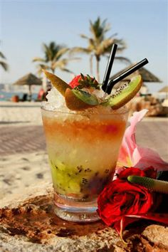 Kiwi & Strawberry Fruit Mojito: Mix 1 kiwi & 5 strawberries with 60g brown sugar. Add crushed ice & 45ml white rum. Mix & top with crushed ice. Add 30ml red rum & garnish with melon & passion fruit.