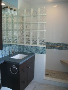 Smaller sized master bath with blue mosaic decorative glass tile, glass block and pebbled shower floor-Kitchen + Bath | Design + Construction.