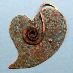 Hand Forged Rustic Copper Heart Pendant Component by SunStones, $16.00  This heart shaped component is made from a sheet of copper which I designed, hand cut with a jeweler's saw, hammered, and filed the edges. After those processes were completed, I let the piece sit in a covered container for 24 hours with salt/vinegar/ammonia to give it that beautiful rustic patina. I wire wrapped a swirl from copper wire and torch painted it - then riveted it on to the heart - this functions as a bail.