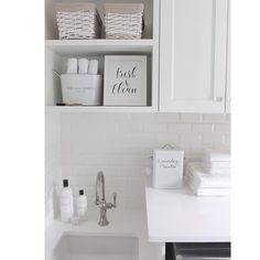 White laundry room, subway tile, laundry room decor @JSHOMEDESIGN