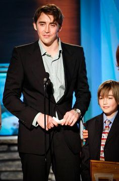 Lee Pace and child actor who played little Ned accepts the award for Pushing Daisies at the Family Television Awards, 2007.