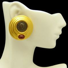BOLD! Great looking vintage coin replica earrings with scored circles and red glass stones. $42.50 From https://www.etsy.com/shop/MyClassicJewelry #myclassicjewelry #vintageearrings #coinearrings #glassearrings