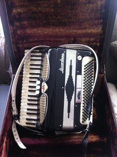 1940's accordion .. I don't what it was but accordion's seem to be popular back in the day... my cousin drove me nuts playing the darn thing....not my favorite instrument :)