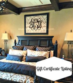Love the chocolate color and the bounty of pillows on the bed.Wall decor made with damask background with painted #monogram placed above the bed. A beautiful #trayceiling to look up at as you relax at the end of the day.