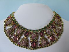 A striking art glass and rhinestone collar necklace that is from the 1960's - 70's.