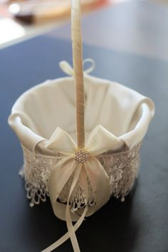 Ivory Wedding Flower Girl Basket \ Cream Lace Flower Girl Basket \ Ivory Lace Basket \ Flower Petals Basket \ Ceremony Bridal Accessories Basket measures: 6.3 inches in diameter. Other wedding accessories can be made with basket - just let me know! LEASE NOTE: Please note your wedding date in the notes to seller box at the checkout:) Beautiful wedding basket. Made of satin, ribbon and brooch. Made personally by me in my: SMOKE & PET FREE HOME The ribbon on this basket can be changed to...