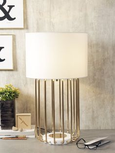 Spencer - A striking addition to any home, the Spencer Table Lamp boasts a metallic gold finish base with a faux white silk shade. This piece exudes unparalleled luxury and sophistication. Decoration Lights For Home, Light Decorations, Home Decor, Luxury Lighting, Lighting Store, Luxury Table Lamps, Wall Lights, Ceiling Lights, White Silk