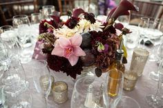 Deep plum and purple centerpiece with mercury glass candle holders.