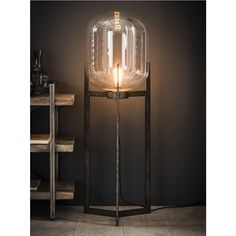 This floor lamp is equipped with a glass shade, which is in a steel frame with a silver finish. A tough lamp with glass and metal combined. Industrial Floor Lamps, Industrial Living, Drop Lights, Wall Lights, Candle Sconces, Wall Sconces, Sconces Living Room, Glass Holders, Affordable Furniture