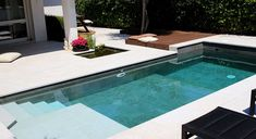 Piscina deck de madera piscina swimmingpool dise o for Cuanto cuesta construir una piscina en chile