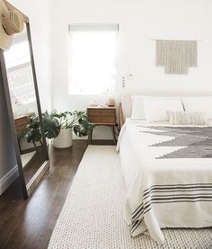 almost makes perfect bedroom. A little too white but I love the bed and blanket.