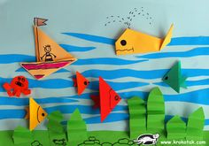 ocean-floor collage: origami fish, whales and accordion fold seaweed. Sea Crafts, Summer Crafts For Kids, Paper Crafts For Kids, Craft Stick Crafts, Art For Kids, Diy And Crafts, Arts And Crafts, Origami Fish, Origami Paper