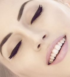 Cat eyes. To create this look use liquid eyeliner and swipe from beginning of eyelid to just after the lashes. For more beauty tips look for blogs and pins from The Style Lounge