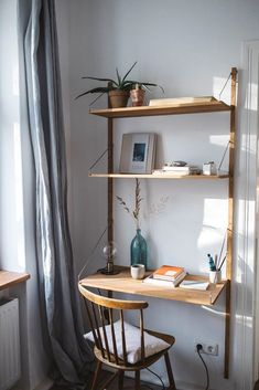 hanging desktop on the wall - scandinavian design - wood and metal - hanging shelf system inspiration