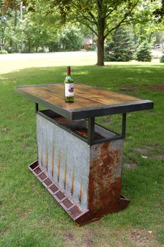 Hog feeder bar made with a vintage creep feeder and reclaimed wood