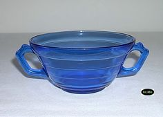 Pattern Name: Moderntone | Manufacturer: Hazel Atlas | Years Made: 1934 - 1942 | Primary Colours: Amethyst, Cobalt blue | Other Colours: Crystal, Pink | Pattern consists of a cup and saucer, creamer and sugar, a number of sizes of bowls, plates and tumblers, a butter dish, cheese dish, custard cup, salt and pepper shakers, sherbet and two sizes of platters. | 5